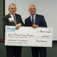 Gerald Barbini accepts check from Murray Kessler
